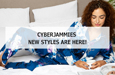 Women laying on bed wearing Cyberjammies pyjamas